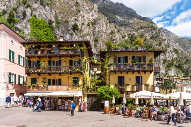 limone-sul-garda-italy-april-picturesque-view-lake-beautiful-spring-day-central-street-tourists-cafes-shops-144661806